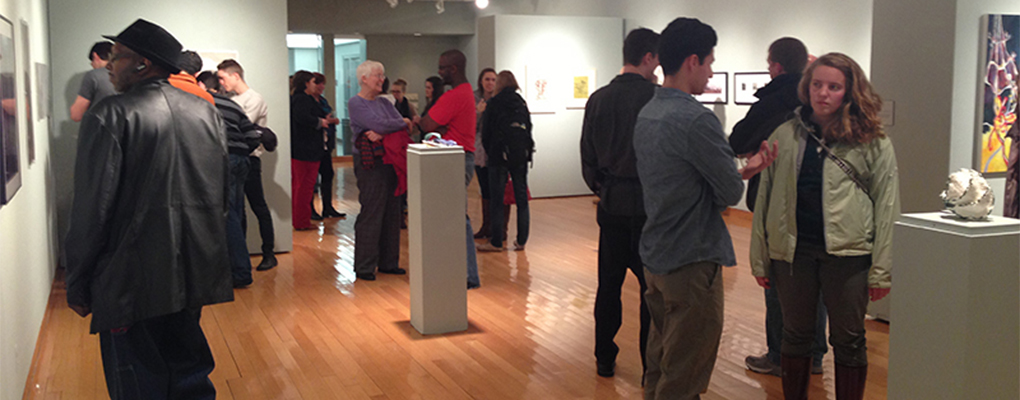 People mingle at a show in Hiestand Galleries