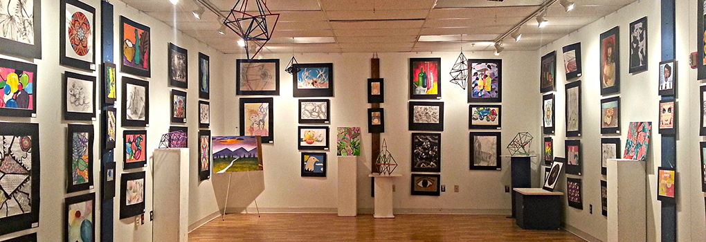 Display of colorful artwork at Northwestern High School Student Art Gallery