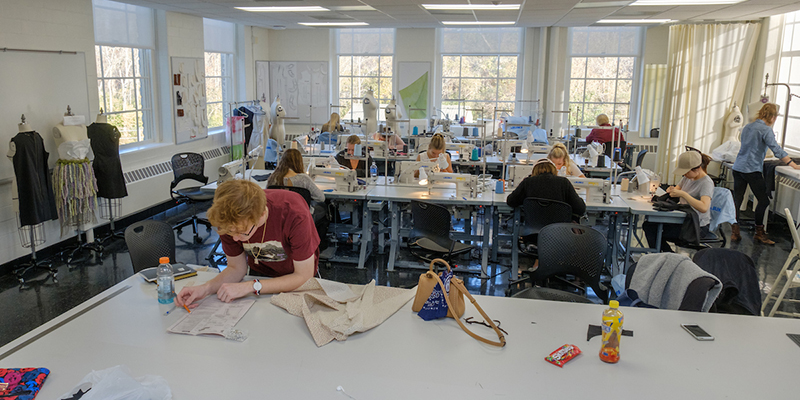 View of students working in the fashion design classroom