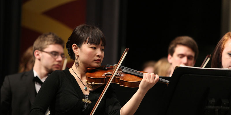 The Miami University Symphony Orchestra performs onstage