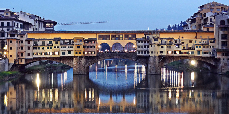 Nighttime view of Ponte Vecchio in Florence