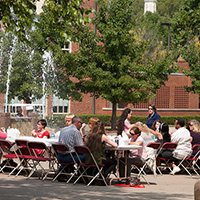 Arts Day participants eating lunch on the Fine Arts Plaza