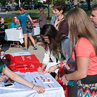 Students sign in at Arts Day registration table