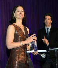 Anne Prammaggiore accepts Lookingglass Civic Engagement Award from actor David Schwimmer