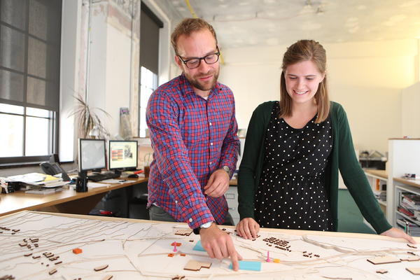Professor and student examine an architectural project