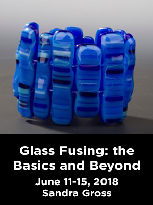 A glass sculpture. Text: Glass Fusing: the basics and beyond. June 11-15 2018 Sandra Gross