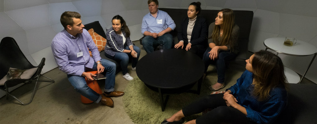 Students converse at a networking event in San Francisco
