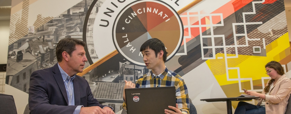 International student confers with his supervisor at Union Hall in Cincinnati