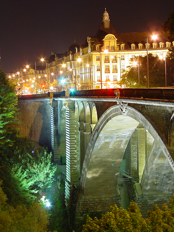 A nighttime view of the bridge and Luxembourg City