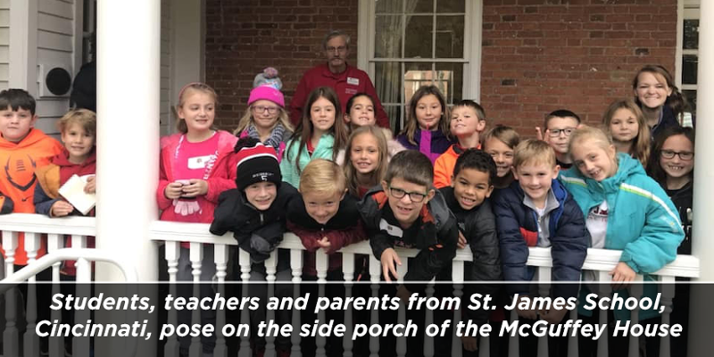 Students, teachers and parents from St. James School, Cincinnati, pose on the side porch of the McGuffey House