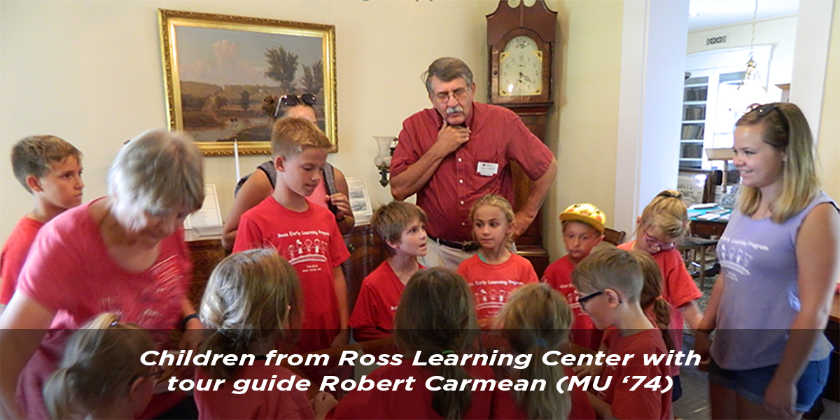Children from Ross Learning Center with tour guide Robert Carmean, MU '74.