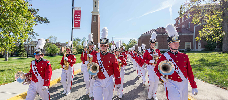 The Miami Marching Band processes to President Crawford