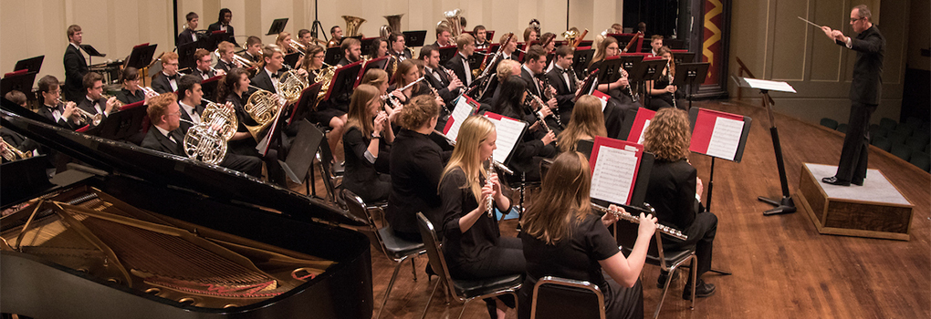 Symphony Band performing onstage at Hall Auditorium
