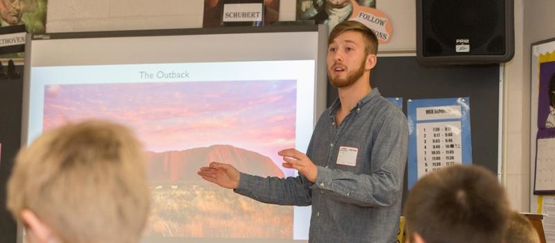 A student teacher presents a PowerPoint on Australian music to the class