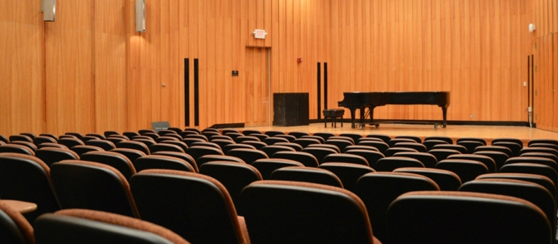 Interior of Souers Recital Hall, empty except for piano onstage
