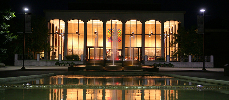 Exterior of CPA at night with fountain