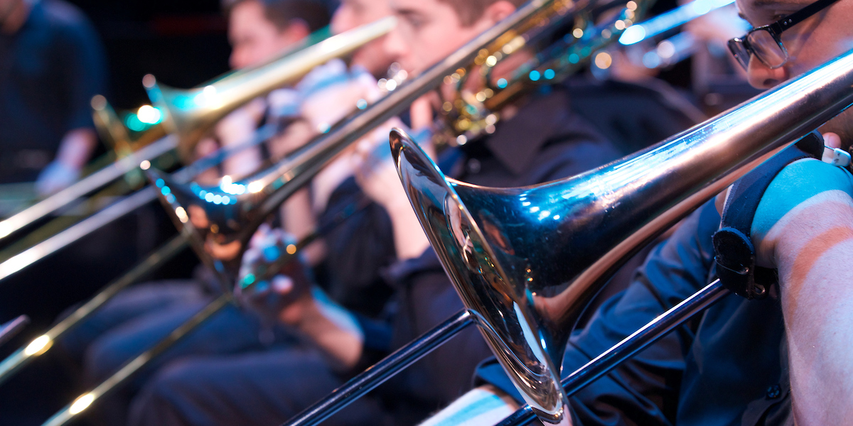 A row of trombones seen during a Jazz Ensemble performance