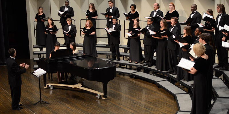 Chamber singers onstage at Hall Auditorium