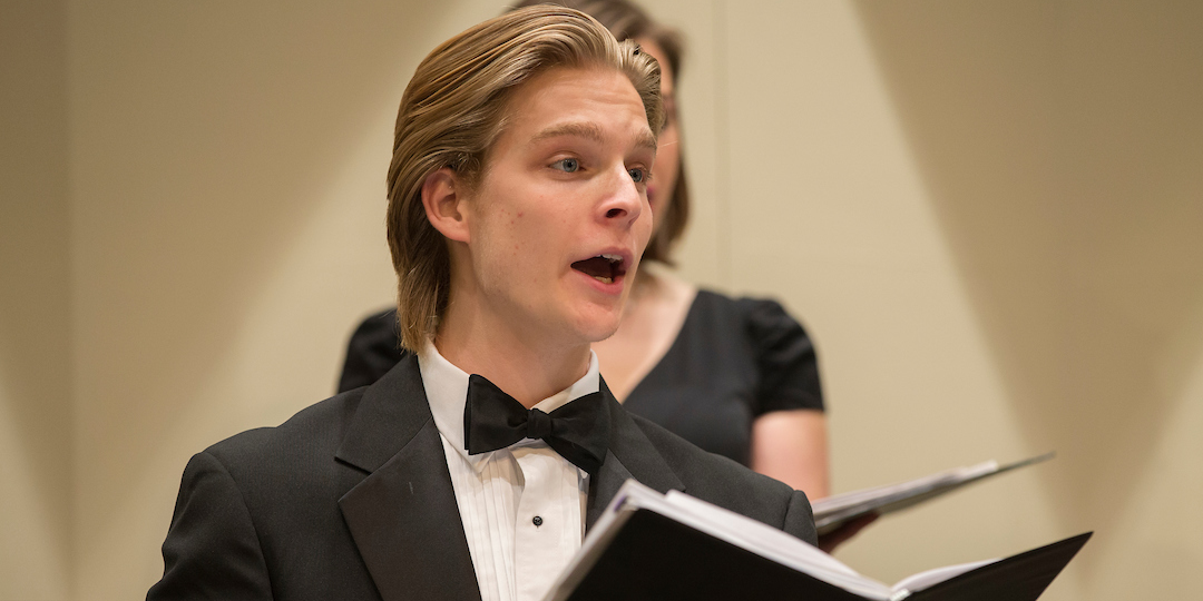 A closeup of a Chamber Singers male performer