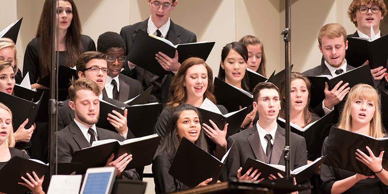 Closeup of a grouping of Collegiate Chorale singers in concert at Hall Auditorium