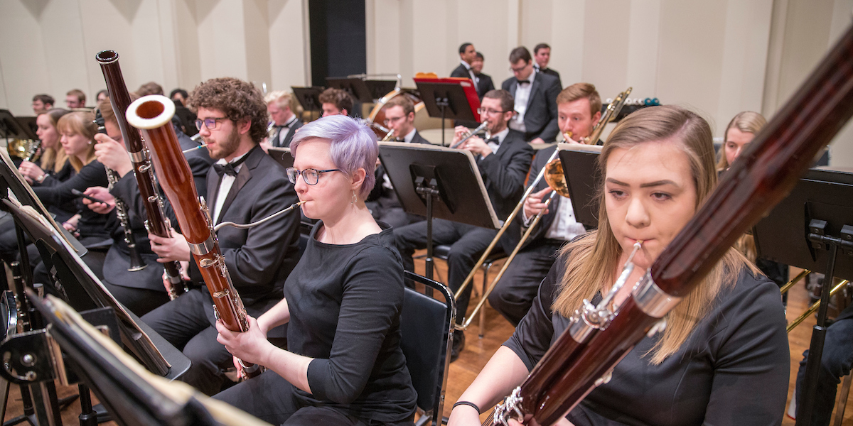 Bassoon players perform during orchestra concert