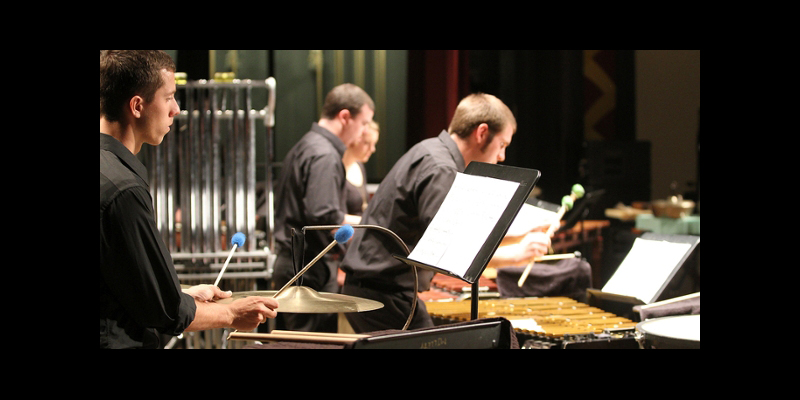 Percussion Ensemble viewed from the side of the stage, showing mallet players and instruments
