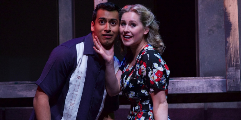 A surprised-looking man poses next to a woman in Street Scene Musical