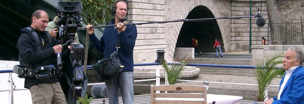 A camera operator and boom operator recording a scene
