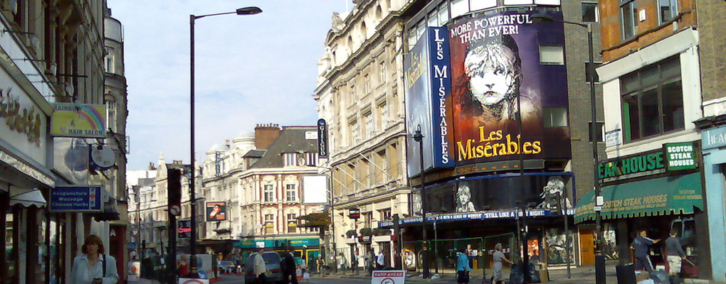 The street in London's West End Theatre district, with a marquee for Les Miserables visible