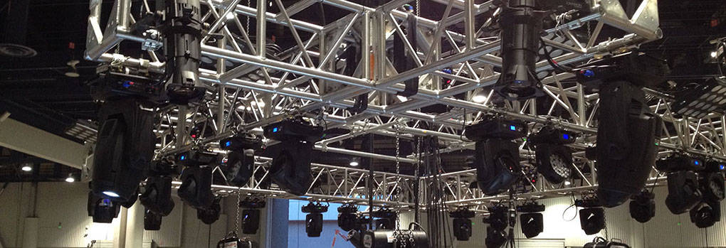 A shot of theatre lighting rigging in the rafters