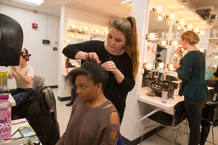 Students applying makeup for theatre production