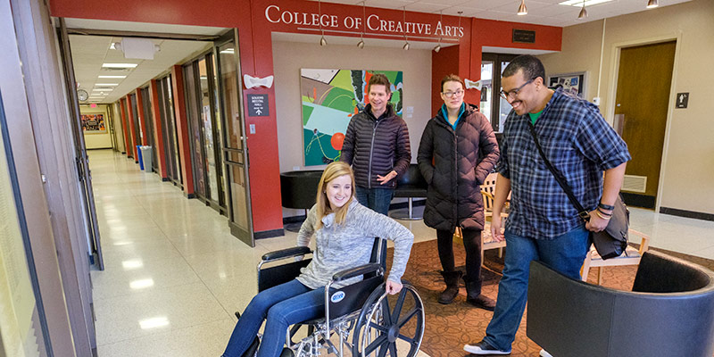 students using a wheelchair in a building to study usability