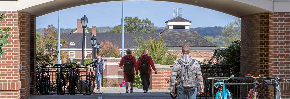Students walking between Benton Hall and the Engineering Building toward North Quad