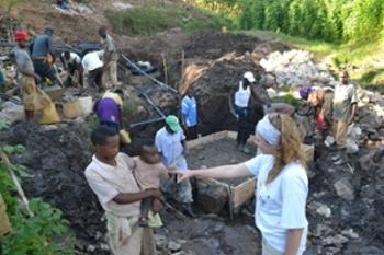 katie-rwanda-community-water-boxes.jpg