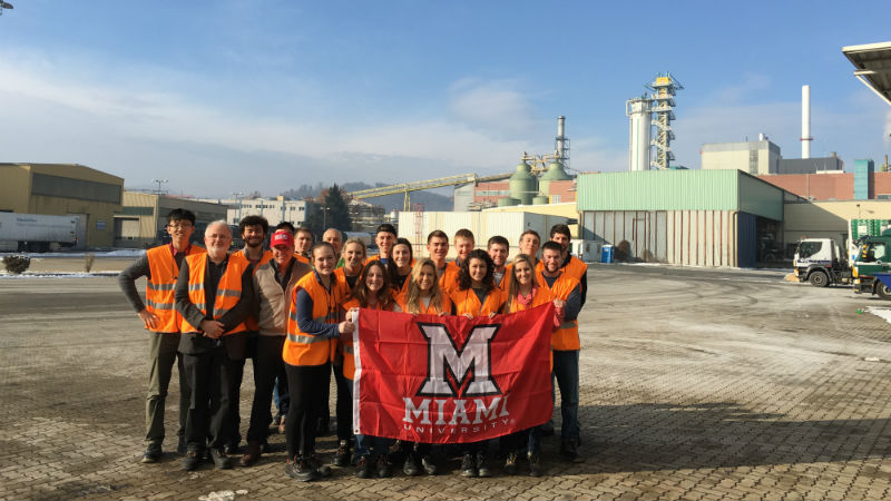 Students hold Miami flag in Graz
