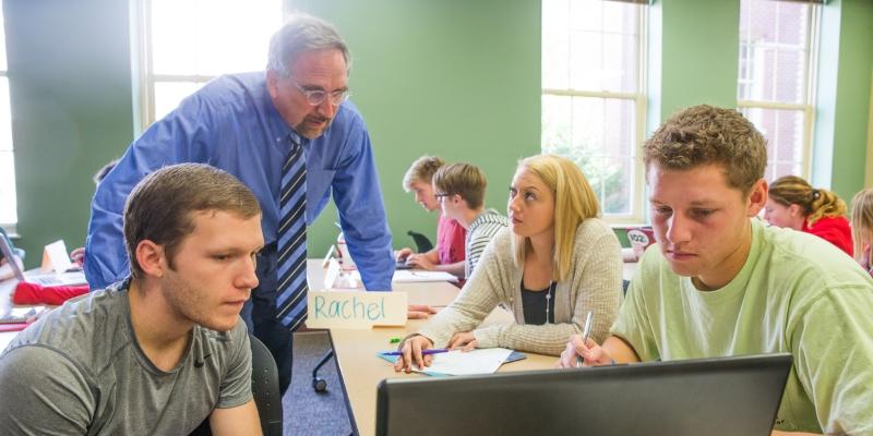 Dr. Boone teaching class.