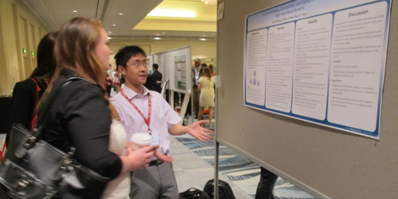 Student shares research with conference attendees