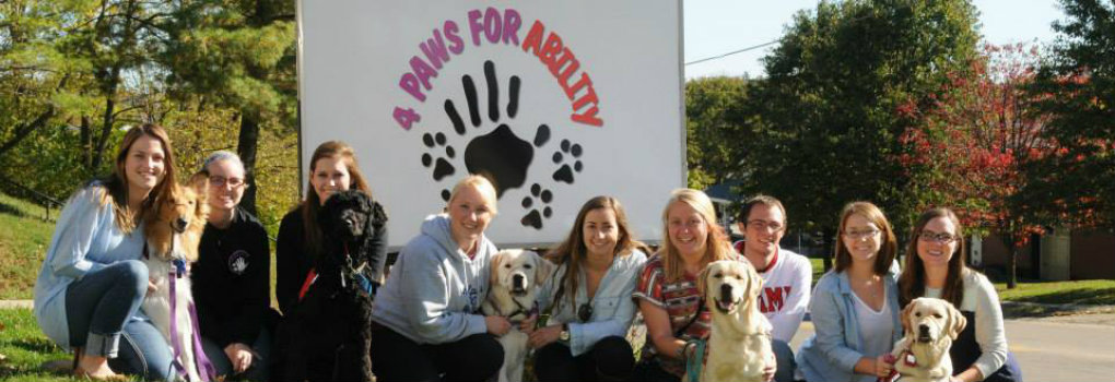 students participating in the Paws for Miami Program