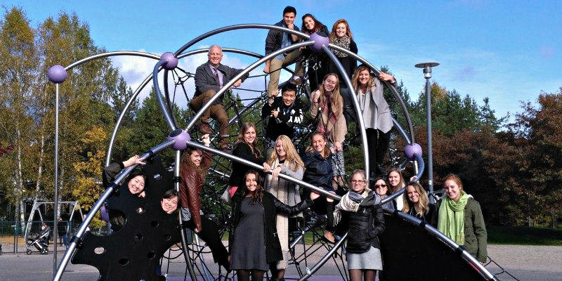 students take picture on a spherical object while studying abroad in Finland