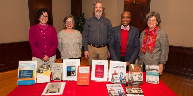 ehs faculty stand over books they wrote