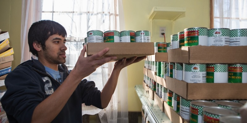 student at a food bank