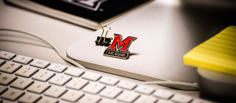 miami logo magnet attached to a computer