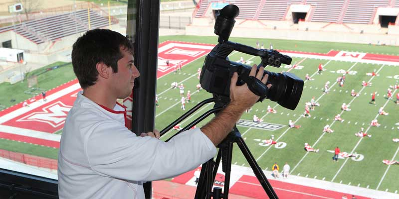 Student filming football game