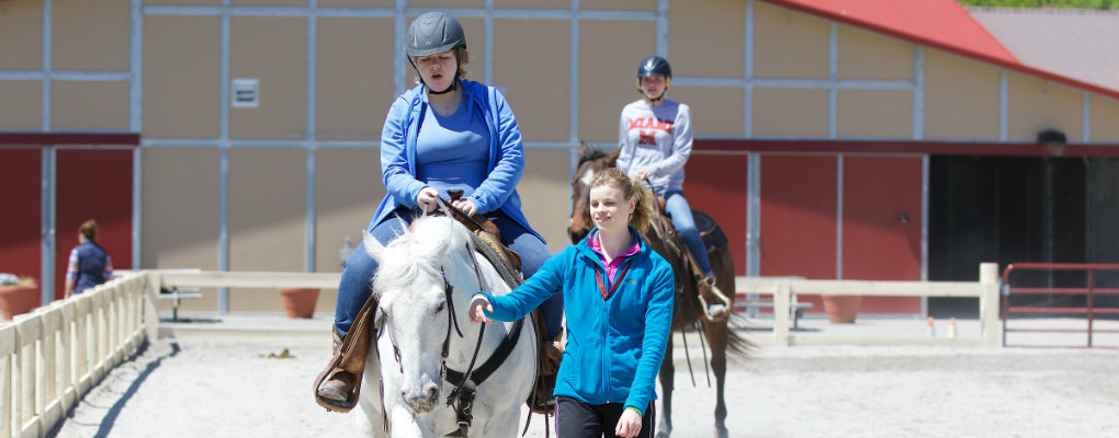 students riding horses