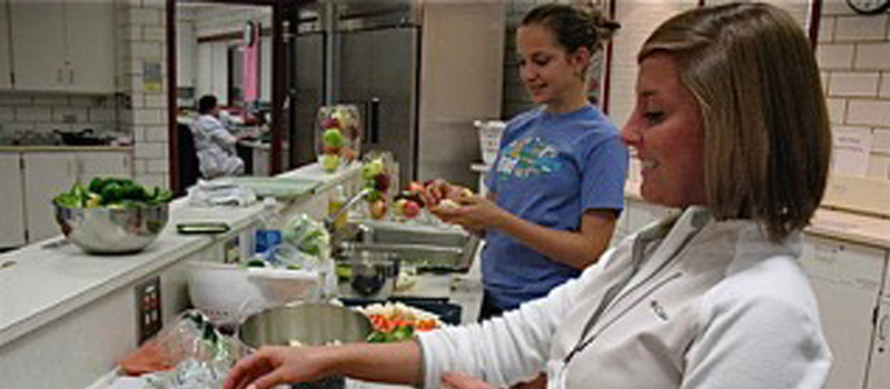 two students cooking in a dietetics lab