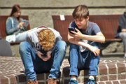 kids-on-phones180x120.jpg