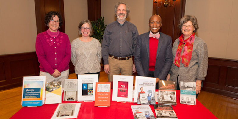 Five Miami University faculty members showcasing their books and other publications.