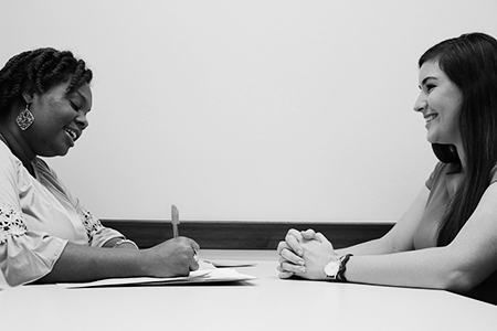 picture of a student interviewing with an staff member