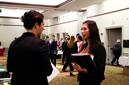 A student interviews with an employer at the Sports Networking Expo