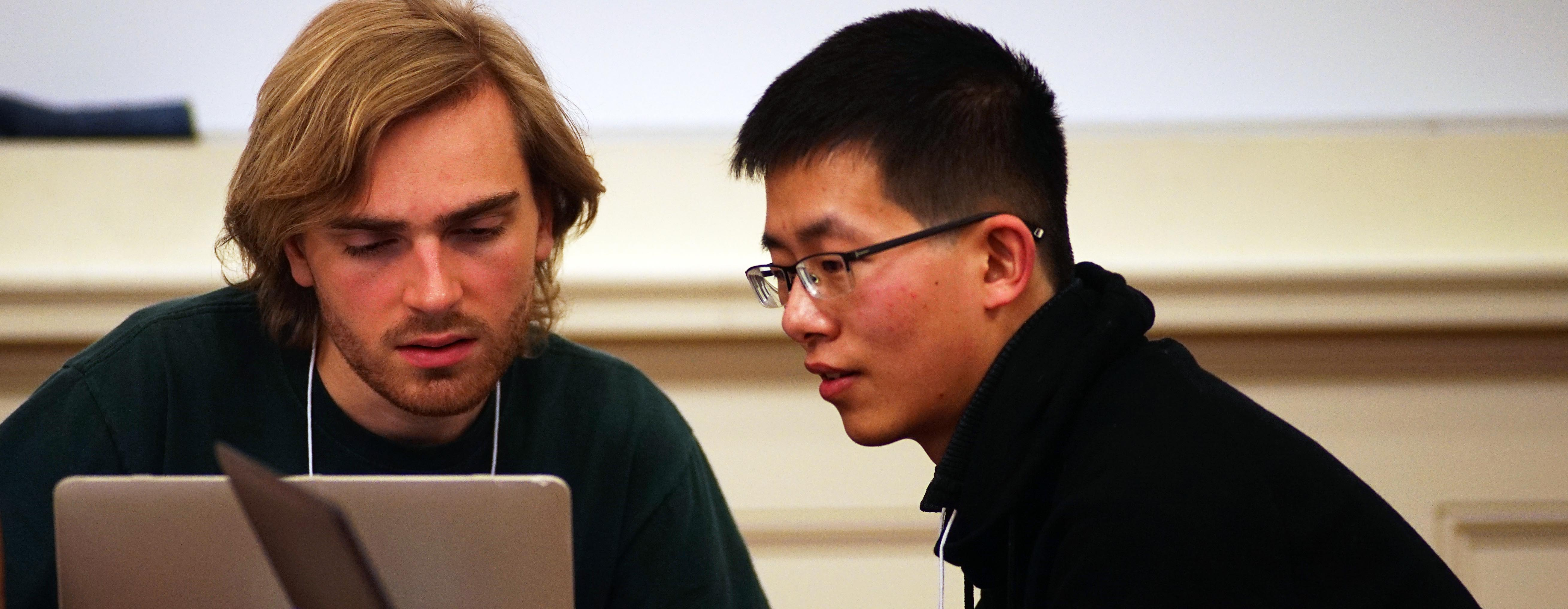 Students work together on a laptop at DataFest
